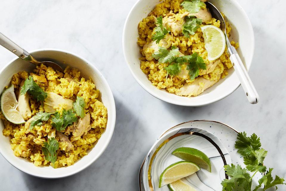 """This chicken-and-rice dish, made in the Instant Pot, is inspired by mulligatawny soup, with vibrant spices, creamy coconut milk, bright ginger, and fresh lime juice. <a href=""""https://www.epicurious.com/recipes/food/views/spiced-coconut-chicken-and-rice?mbid=synd_yahoo_rss"""" rel=""""nofollow noopener"""" target=""""_blank"""" data-ylk=""""slk:See recipe."""" class=""""link rapid-noclick-resp"""">See recipe.</a>"""