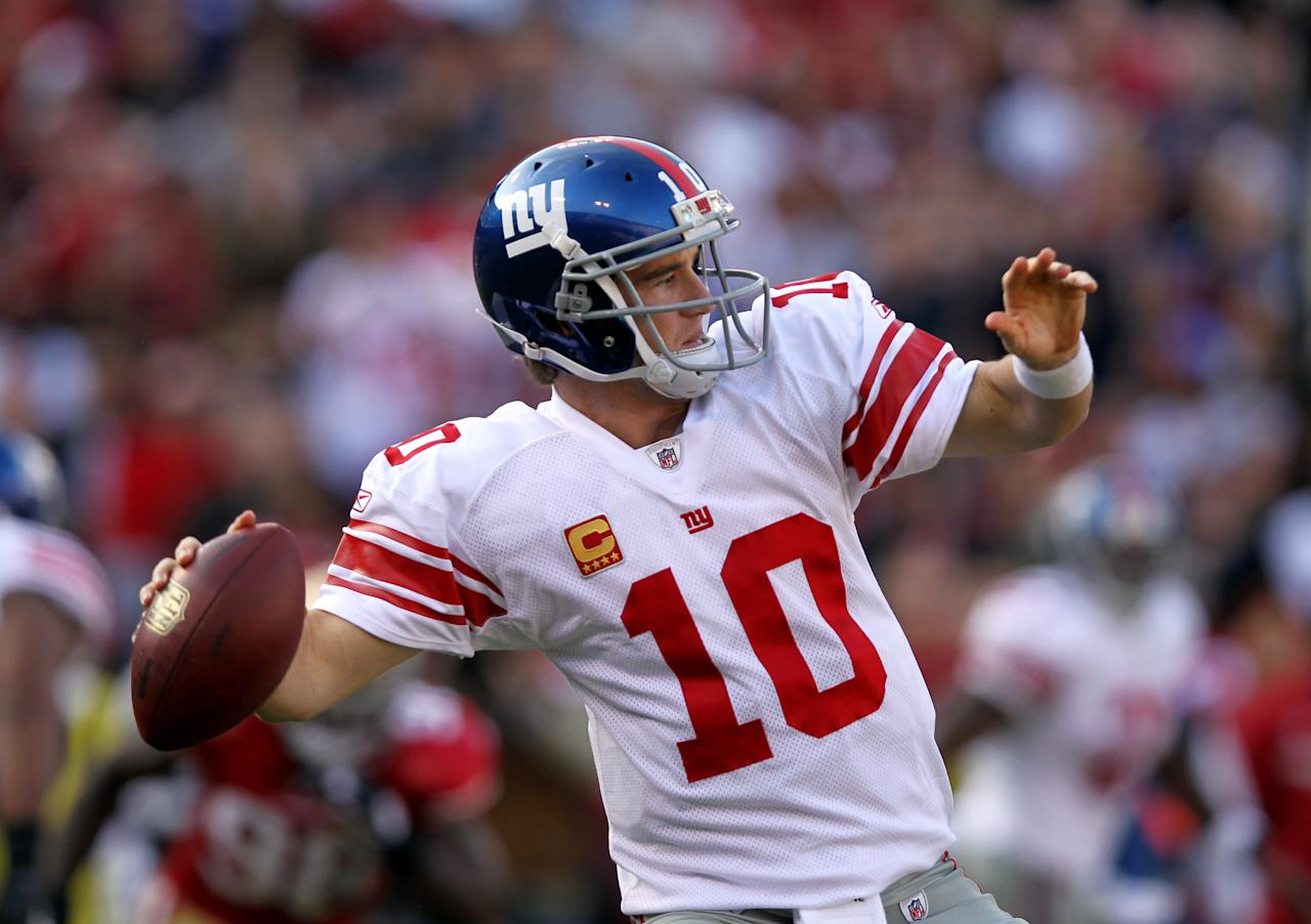 SAN FRANCISCO, CA - NOVEMBER 13:  Eli Manning #10 of the New York Giants throws the ball against the San Francisco 49ers  at Candlestick Park on November 13, 2011 in San Francisco, California.  (Photo by Ezra Shaw/Getty Images)