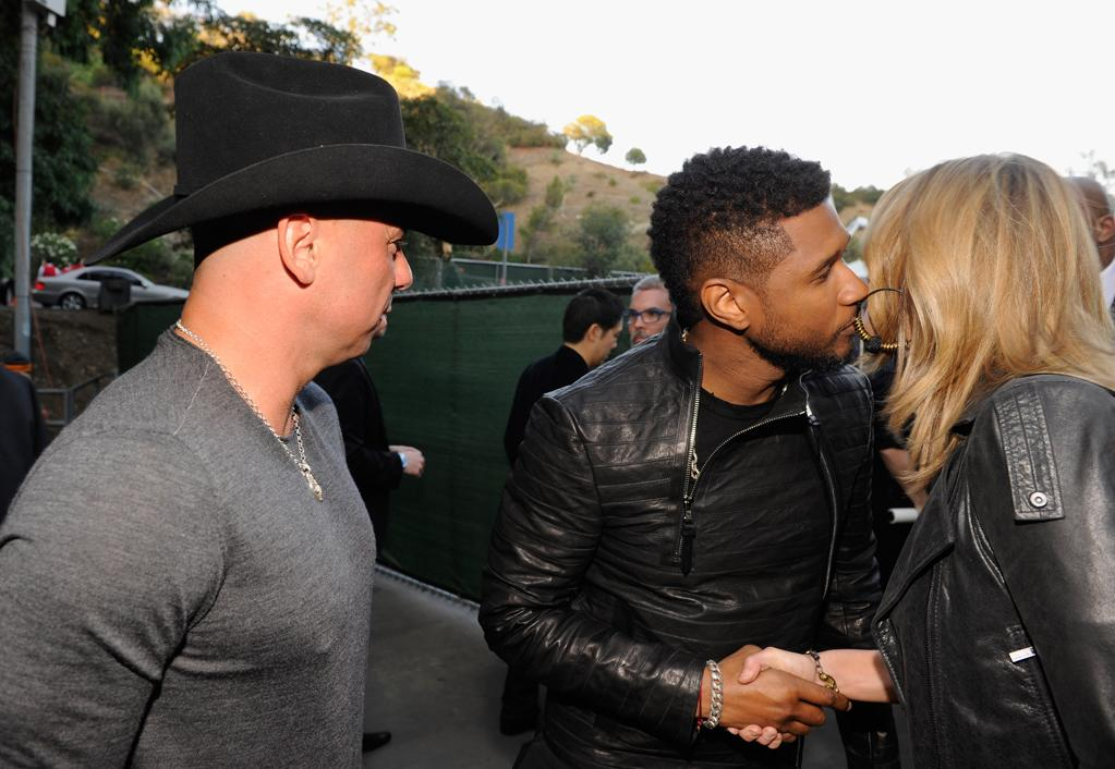 "Kenny Chesney, Usher and Grace Potter backstage at the ""A Decade of Difference"" concert on October 15, 2011, at the Hollywood Bowl, Los Angeles. <br><br>(Photo by Kevin Mazur/Getty Images for Control Room)"