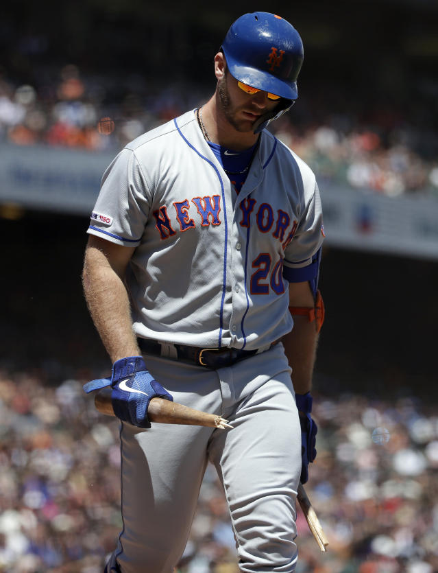 New York Mets' Pete Alonso carries a bat he broke over his knee after striking out against the San Francisco Giants during the third inning of a baseball game in San Francisco, Sunday, July 21, 2019. (AP Photo/Jeff Chiu)