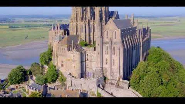 """This stunning drone footage of Le Mont Saint Michel in Normandy was captured by FreeewayDrone as part of the """"Tour De France """":https://freewaydrone.com/tour-de-france-2/?lang=en in 2017.Over a period of three months before the tour began, the group captured drone footage from over 15 different spots throughout France. The footage showcased France's heritage and was featured alongside the live coverage of the Tour de France. Credit: FREEWAY PROD via Storyful"""