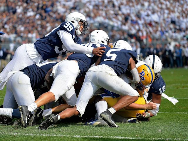 <p>Penn State DE Yetur Gross-Matos (99) and a mass of defenders stop Pitt QB Kenny Pickett (8) short of the end zone during the fourth quarter of the Panthers vs. Nittany Lions on Sept. 14, 2019.</p>