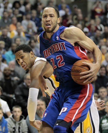Detroit Pistons' Tayshaun Prince goes to the basket against Indiana Pacers' Danny Granger during the first half of an NBA basketball game Monday, Dec. 26, 2011, in Indianapolis. (AP Photo/Darron Cummings)