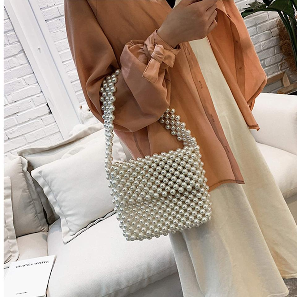 "<p>This chic <a href=""https://www.popsugar.com/buy/Z-synka-Hand-Woven-Pearl-Bag-548639?p_name=Z-synka%20Hand-Woven%20Pearl%20Bag&retailer=amazon.com&pid=548639&price=40&evar1=fab%3Aus&evar9=47213733&evar98=https%3A%2F%2Fwww.popsugar.com%2Ffashion%2Fphoto-gallery%2F47213733%2Fimage%2F47213936%2FZ-synka-Hand-Woven-Pearl-Bag&list1=shopping%2Camazon%2Caccessories%2Cbags%2Chandbags%2Caffordable%20shopping&prop13=mobile&pdata=1"" rel=""nofollow"" data-shoppable-link=""1"" target=""_blank"" class=""ga-track"" data-ga-category=""Related"" data-ga-label=""https://www.amazon.com/dp/B0824KQKMP/ref=sspa_dk_detail_0?psc=1&amp;pd_rd_i=B0824KQKMP&amp;pd_rd_w=wGV5C&amp;pf_rd_p=45a72588-80f7-4414-9851-786f6c16d42b&amp;pd_rd_wg=dPArv&amp;pf_rd_r=KV8VW9XZMD5E9HB36DW6&amp;pd_rd_r=8126f6bf-4e19-4f76-b40d-105b8b83a37a&amp;spLa=ZW5jcnlwdGVkUXVhbGlmaWVyPUEyM1ZGUFY3UUhRMDlUJmVuY3J5cHRlZElkPUEwNDQ4MjMzMk81UkNPRVlNRlY0WCZlbmNyeXB0ZWRBZElkPUEwMzI0OTk3Mkc0UURRU1o1Nkk3WiZ3aWRnZXROYW1lPXNwX2RldGFpbCZhY3Rpb249Y2xpY2tSZWRpcmVjdCZkb05vdExvZ0NsaWNrPXRydWU="" data-ga-action=""In-Line Links"">Z-synka Hand-Woven Pearl Bag</a> ($40) will elevate any outfit.</p>"