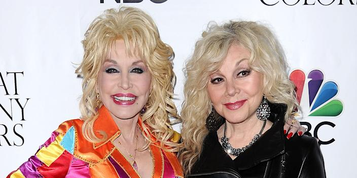"""HOLLYWOOD, CA - DECEMBER 02: Dolly Parton and Stella Parton attend the premiere of """"Dolly Parton's Coat Of Many Colors"""" at the Egyptian Theatre on December 2, 2015 in Hollywood, California. (Photo by Jason LaVeris/FilmMagic)"""