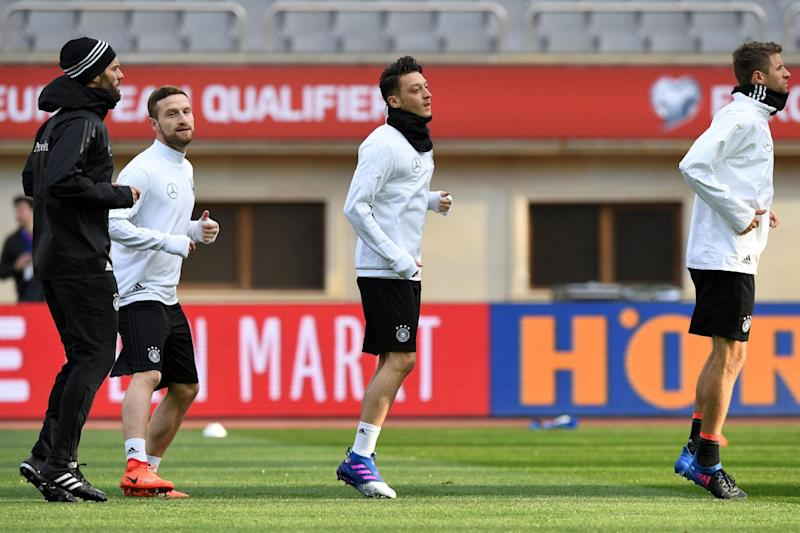 Ozil trains alongside Arsenal team-mate Shkodran Mustafi in Baku: AFP/Getty Images