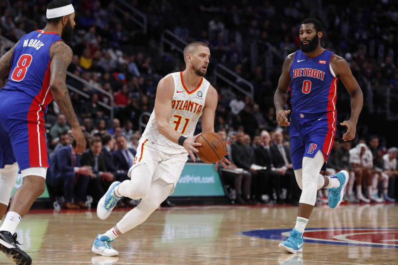 Atlanta Hawks forward Chandler Parsons (31) passes the ball during the second half of an NBA basketball game against the Detroit Pistons, Friday, Nov. 22, 2019, in Detroit. (AP Photo/Carlos Osorio)
