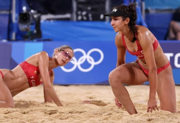 From left to right, Sarah Pavan and Melissa Humana-Paredes of Team Canada react as they compete against Team Australia during their women's quarter-final beach volleyball match on Tuesday in Tokyo's Shiokaze Park. (Sean M. Haffey/Getty Images - image credit)