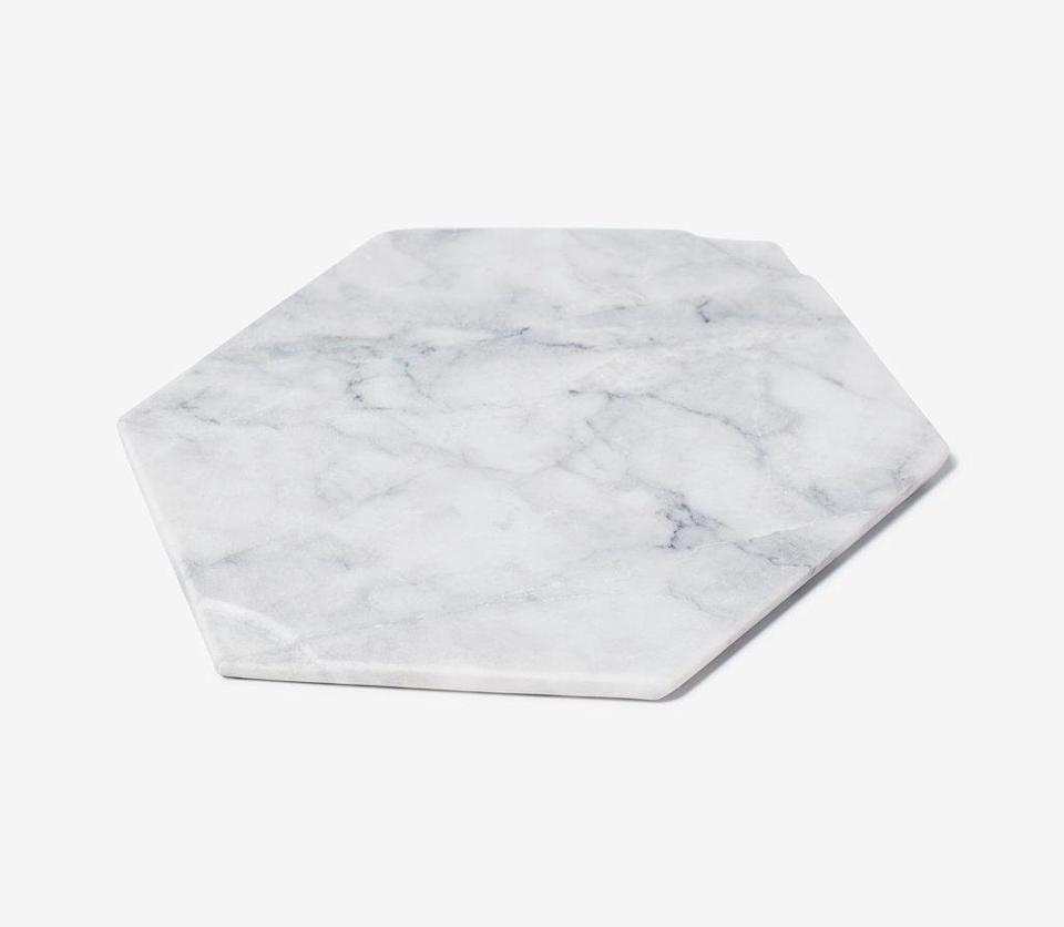 """<h2>Marble Cheese Board</h2><br>A little marble goes a long way when it comes to kitchen decor. Slice your cheese (or chop your veggies) on this luxurious board, expertly crafted in Mexico. <br><br><strong>Snowe</strong> Marble Cheese Board, $, available at <a href=""""https://go.skimresources.com/?id=30283X879131&url=https%3A%2F%2Fsnowehome.com%2Fproducts%2Fmarble-cheese-board%3F"""" rel=""""nofollow noopener"""" target=""""_blank"""" data-ylk=""""slk:Snowe"""" class=""""link rapid-noclick-resp"""">Snowe</a>"""