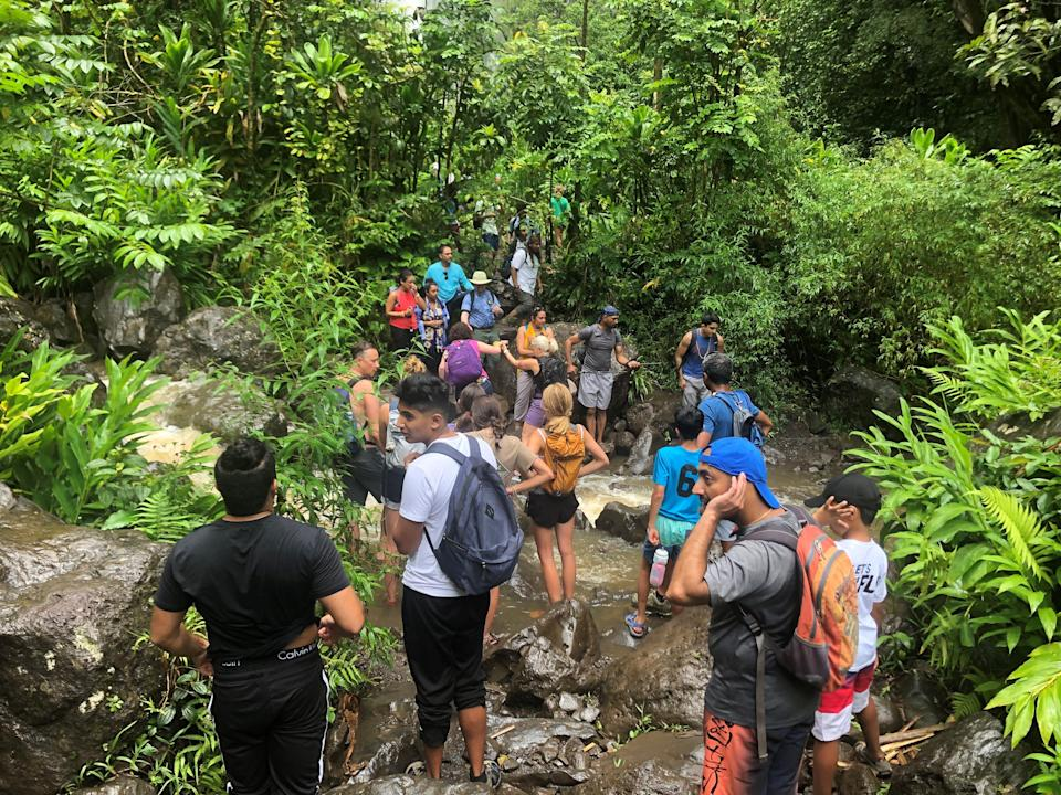 Hikers reach the end of the Pipiwai Trail at Haleakala National Park on the Hawaiian island of Maui. The 4-mile round-trip hike, which features a bamboo forest and the stunning Waimoku Falls, is at the end of the long road to Hana.