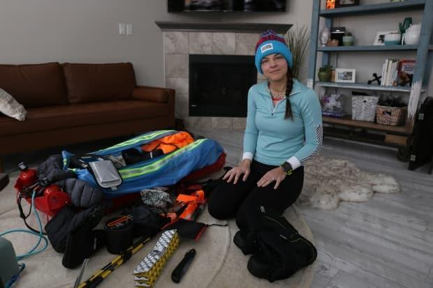 Jessica Leska is dragging all of her gear behind her on a sled. (Jamie Malbeuf/CBC - image credit)