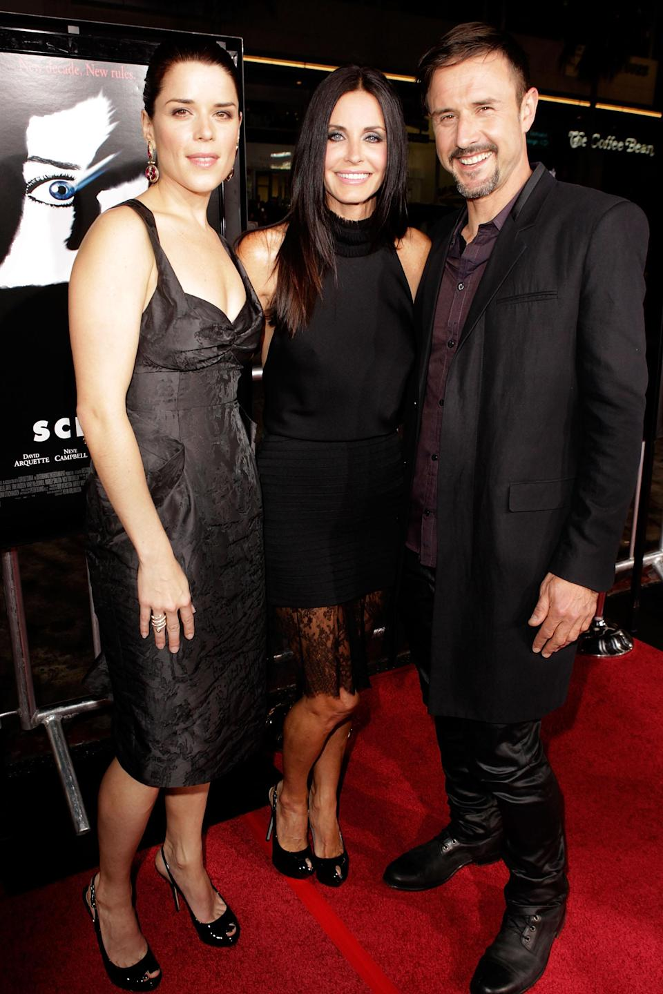 By the premiere of <em>Scream 4</em> in April 2011, David Arquette's marriage to Courteney Cox was over. The pair still posed for photographs, though, like here, with co-star Neve Campbell. (Photo: John Shearer/WireImage)