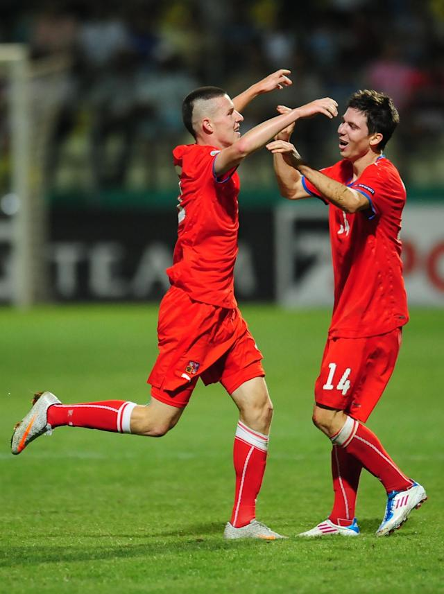 Czech Republic's Patrik Lacha (L) celebrates with Tomas Prikryl (R) after scoring the second goal of his team against Spain during their UEFA European Under-19 Championship 2010/2011 final football match in Chiajna village next to Bucharest August 1, 2011. AFP PHOTO/DANIEL MIHAILESCU (Photo credit should read DANIEL MIHAILESCU/AFP/Getty Images)
