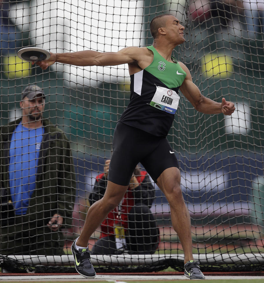 Ashton Eaton throws a discus during the decathlon competition at the U.S. Olympic Track and Field Trials Saturday, June 23, 2012, in Eugene, Ore. (AP Photo/Matt Slocum)