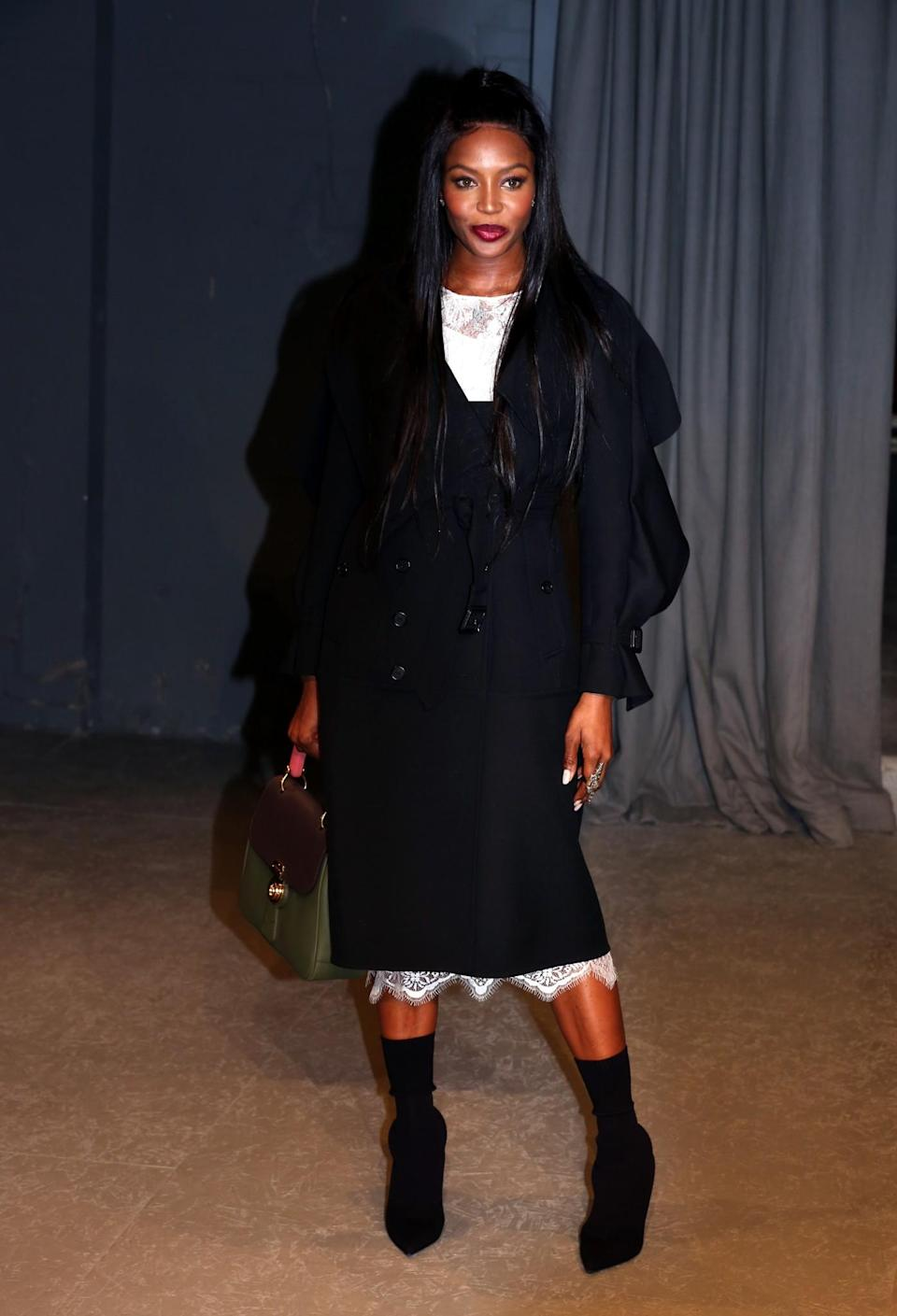 <p>Naomi Campbell covered up in an oversized coat. <i>[Photo: PA]</i> </p>