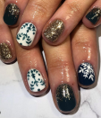 "<p>Skip the bright reds and greens for this rich forest color that <a href=""https://www.instagram.com/offtoneverlandnails/"" rel=""nofollow noopener"" target=""_blank"" data-ylk=""slk:Neverland Nails"" class=""link rapid-noclick-resp"">Neverland Nails</a> brightened up with the help of gold glitter accents. </p><p><a class=""link rapid-noclick-resp"" href=""https://www.amazon.com/OPI-Polish-Collection-Lacquer-Glitter/dp/B07TF9S1WK?tag=syn-yahoo-20&ascsubtag=%5Bartid%7C10072.g.34113691%5Bsrc%7Cyahoo-us"" rel=""nofollow noopener"" target=""_blank"" data-ylk=""slk:SHOP GOLD POLISH"">SHOP GOLD POLISH</a></p>"