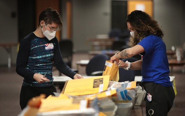 Election officials count absentee ballots in Milwaukee, Wisconsin - Getty Images North America