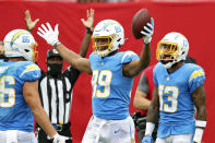 Los Angeles Chargers tight end Donald Parham Jr. (89) celebrates with tight end Hunter Henry (86) and wide receiver Keenan Allen (13) after Parham scored against the Tampa Bay Buccaneers during the first half of an NFL football game Sunday, Oct. 4, 2020, in Tampa, Fla. (AP Photo/Mark LoMoglio)