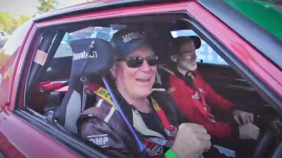 Shane Navin (pictured left) with Glenn Evans (pictured right) smiling in their Mazda RX7 during the Targa Great Barrier Reef.