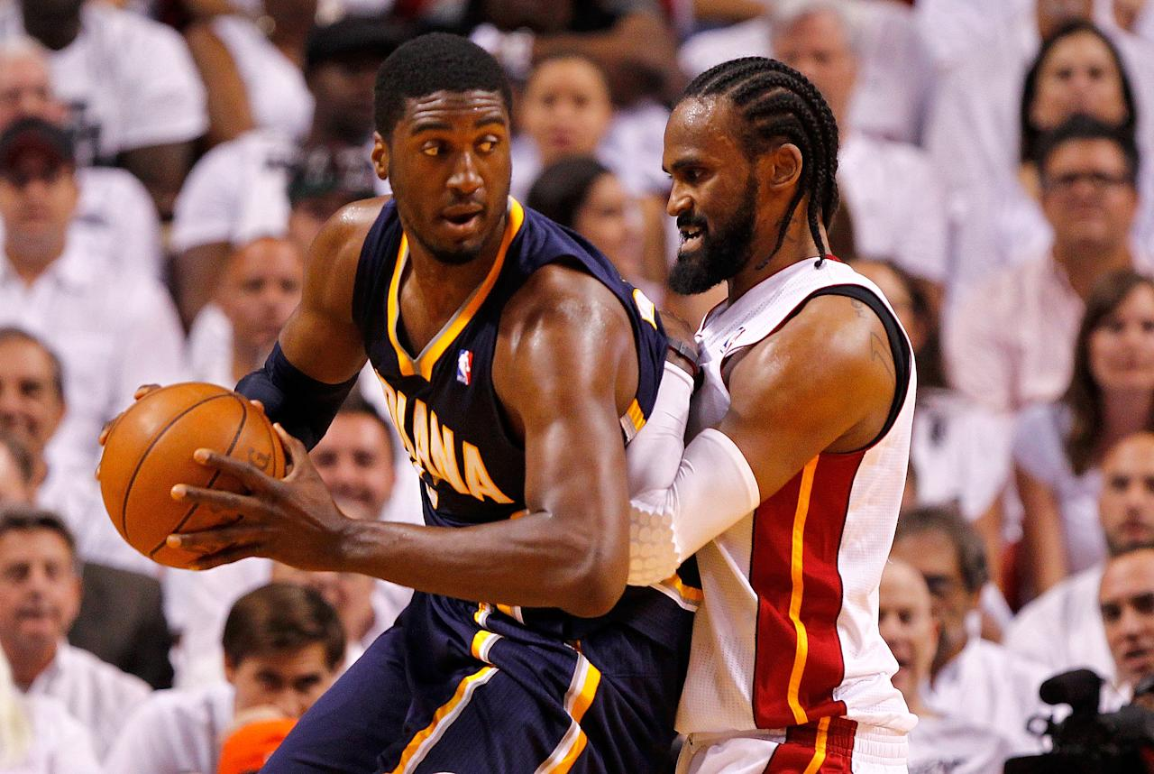 MIAMI, FL - MAY 15:  Roy Hibbert #55 of the Indiana Pacers posts up Ronny Turiaf #21 of the Miami Heat during Game Two of the Eastern Conference Semifinals in the 2012 NBA Playoffs  at AmericanAirlines Arena on May 15, 2012 in Miami, Florida. NOTE TO USER: User expressly acknowledges and agrees that, by downloading and/or using this Photograph, User is consenting to the terms and conditions of the Getty Images License Agreement.  (Photo by Mike Ehrmann/Getty Images)