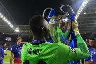 Chelsea's goalkeeper Edouard Mendy celebrates with the trophy after winning the Champions League final soccer match between Manchester City and Chelsea at the Dragao Stadium in Porto, Portugal, Saturday, May 29, 2021. (AP Photo/Manu Fernandez, Pool)
