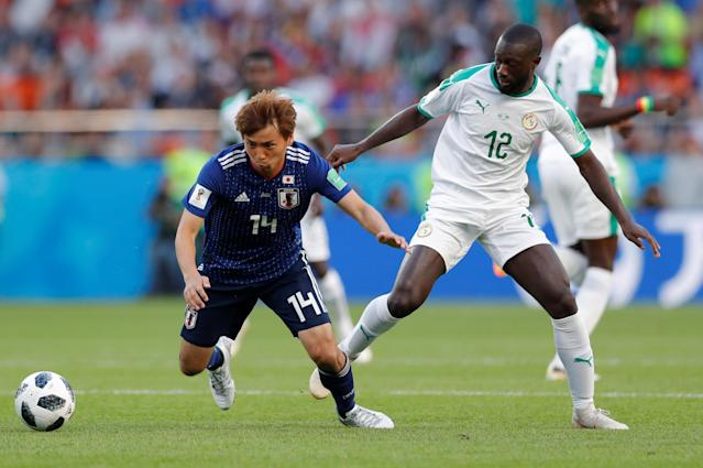 Soccer Football - World Cup - Group H - Japan vs Senegal - Ekaterinburg Arena, Yekaterinburg, Russia - June 24, 2018 Japan's Takashi Inui in action with Senegal's Youssouf Sabaly REUTERS/Andrew Couldridge