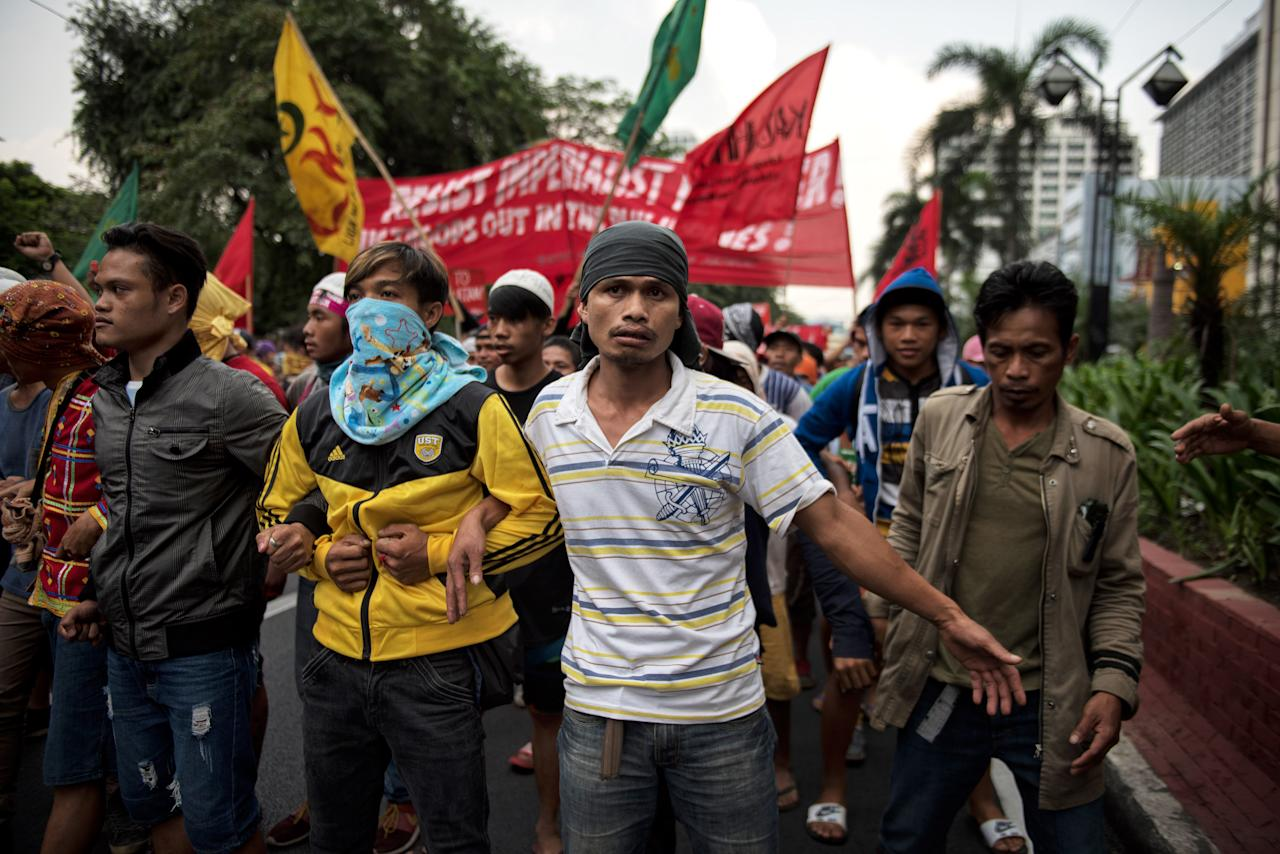 <p>Protesters march the streets of Manila a day ahead of President Trump's arrival on Nov. 11, 2017 in Manila, Philippines. (Photo: Jes Aznar/Getty Images) </p>