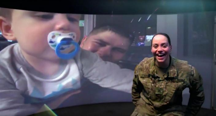This image made from a video provided by Hyundai Motor America shows an image from the company's Super Bowl 51 commercial recorded on a U.S. military base in Zagan, Poland. Hyundai aired the ad right after the Super Bowl 51 football game between the Atlanta Falcons and the New England Patriots that was recorded while the Super Bowl was underway in Houston, Sunday, Feb. 5, 2017. The 90-second spot shows U.S. troops at the military base in Poland watching the game. A few service members are called into a room, where they are connected virtually to their family members — who are at the game. (Hyundai Motor America via AP)