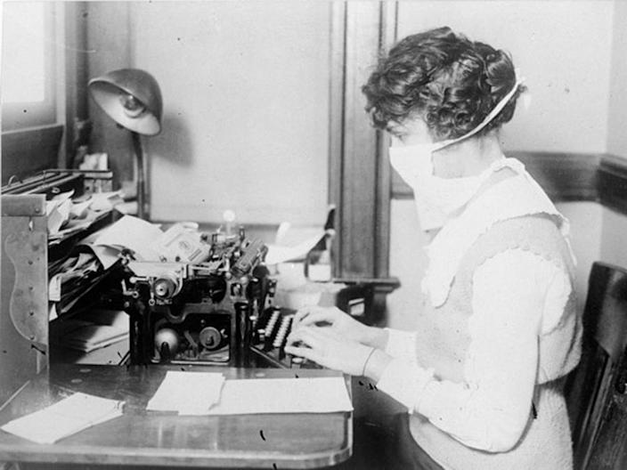 Typist with medical mask, 1918 flu