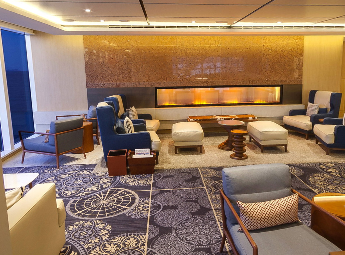 <p>Viking Cruises are full of cosy reading nooks like these where you can sit by the fireplace, gaze out at the ocean through panoramic windows and read a book you found from the on-board library. Source: Viking Ocean Cruises. </p>