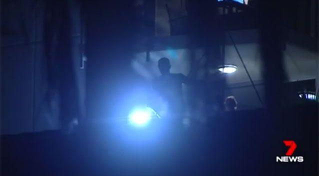 Police searching in the dark. Source: 7News
