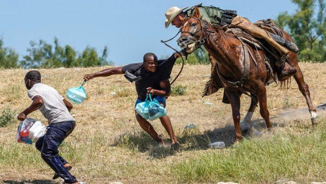 The photos, which were captured over the weekend, showed US Border Patrol agents on horseback swinging lariats, a rope used by horse riders, while trying to block the passage of Haitian border-crossers. According to reports, some 13,000 mainly Haitian migrants have gathered in a makeshift camp under a bridge connecting Del Rio to Mexico's Ciudad Acuña on the US-Mexico border. AFP