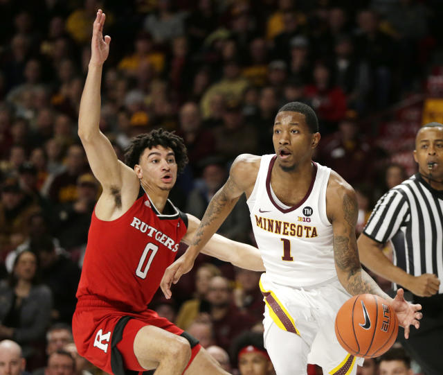 Minnesota guard Dupree McBrayer (1) drives past Rutgers guard Geo Baker (0) during the first half of an NCAA college basketball game, Saturday, Jan. 12, 2019, in Minneapolis. (AP Photo/Andy Clayton-King)