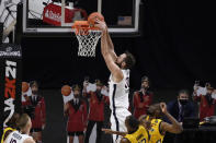 Virginia's Jay Huff dunks over Virginia in the first half of an NCAA college basketball game, Wednesday, Nov. 25, 2020, in Uncasville, Conn. (AP Photo/Jessica Hill)