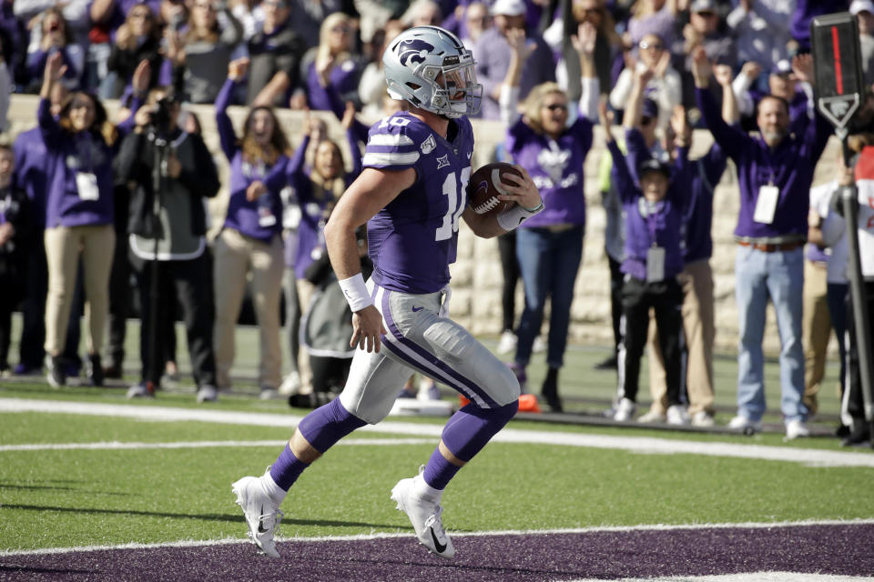 Kansas State quarterback Skylar Thompson (10) runs into the end zone to score a touchdown during the first half of an NCAA college football game against Oklahoma Saturday, Oct. 26, 2019, in Manhattan, Kan. (AP Photo/Charlie Riedel)