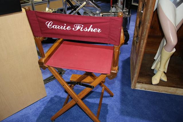"<p><a href=""https://www.yahoo.com/movies/tagged/carrie-fisher"" data-ylk=""slk:Carrie Fisher"" class=""link rapid-noclick-resp"">Carrie Fisher</a>'s personalized chair from <a href=""https://www.yahoo.com/movies/film/return-of-the-jedi"" data-ylk=""slk:Return of the Jedi"" class=""link rapid-noclick-resp""><em>Return of the Jedi</em></a> (Photo: Giana Mucci/Yahoo) </p>"