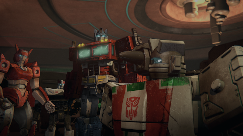 Elita-1 (Linsay Rousseau), Optimus Prime (Jake Foushee), and Wheeljack (Bill Rogers) discuss the fate of Cybertron in Transformers : War for Cybertron Trilogy. (PHOTO: Netflix)