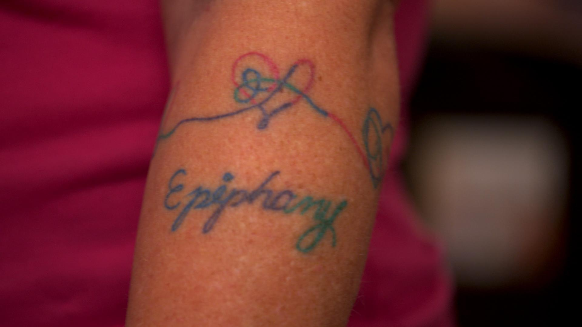 "Russell has an ""Epiphany"" tattoo as a tribute both to the BTS song of the same name and her own life-changing moment."