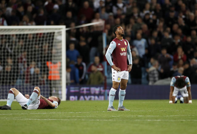 Aston Villa players react at the end of the English Premier League soccer match between Aston Villa and West Ham United at Villa Park in Birmingham, England, Monday, Sept. 16, 2019. (AP Photo/Rui Vieira)