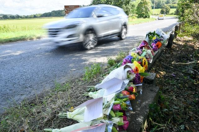 Floral tributes have been left to the four men who died (Ben Birchall/PA)