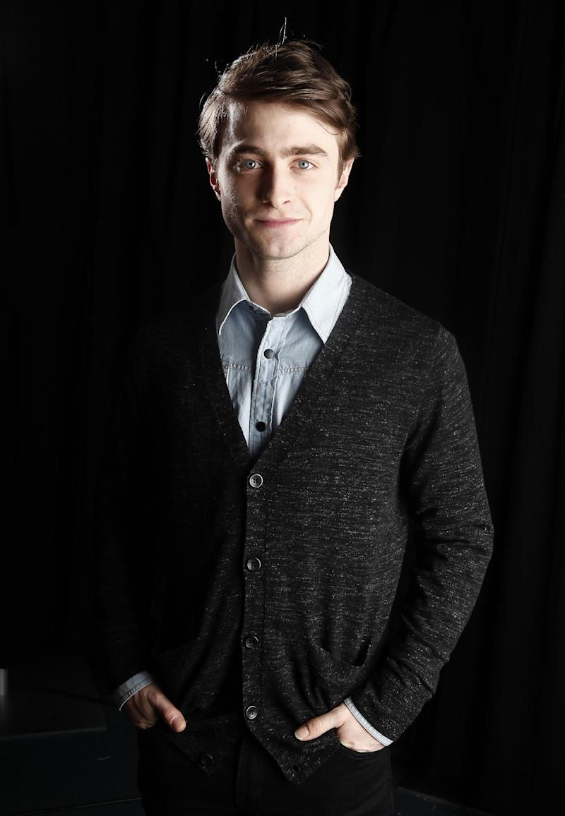 """In this Jan. 6, 2012 photo, actor Daniel Radcliffe poses for a portrait in New York. Radcliffe stars in the upcoming film """"The Woman In Black.""""   (AP Photo/Carlo Allegri)"""
