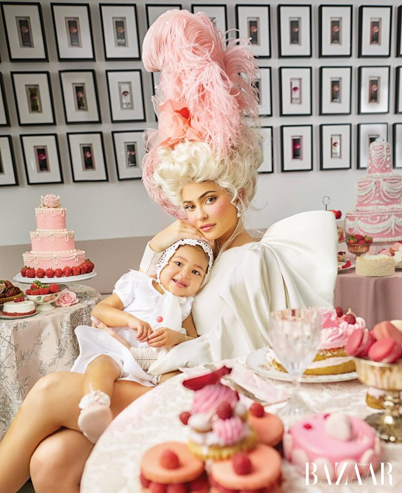 <p>Kylie is wearing a Carolina Herrera dress, Piers Atkinson headband, and Beladora jewelry, while Stormi wears a Susanne Lively Designs dress, Adeline &amp; Frankie by Baby Beau and Belle bonnet, Baby Beau and Belle shoes, and her own bracelet.</p>