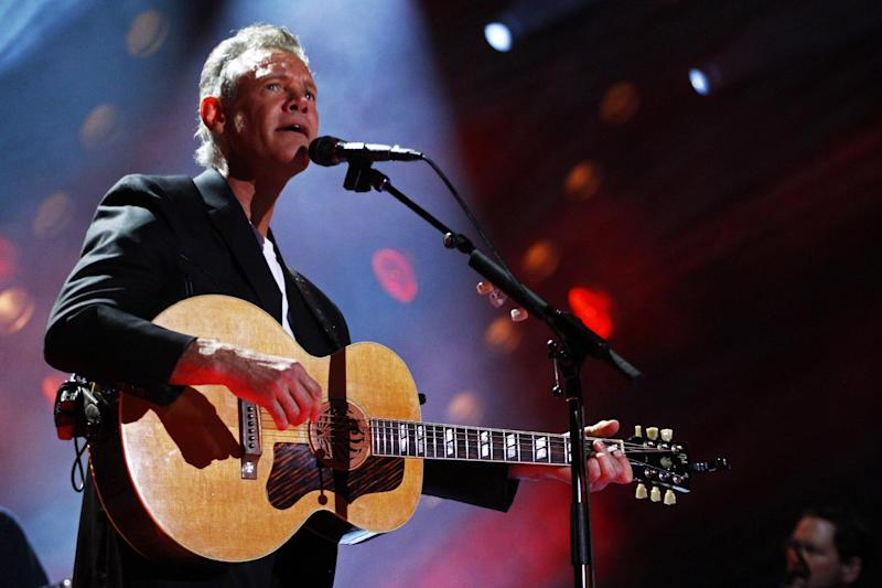 FILE - In this June 7, 2013 file photo, Randy Travis performs on day 2 of the 2013 CMA Music festival at the LP Field in Nashville, Tenn. Travis has been hospitalized in Texas with viral cardiomyopathy. A news release from the singer's publicist says Travis was admitted to the hospital Sunday, July 7, 2013, in Dallas. (Photo by Wade Payne/Invision/AP, File)