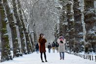 <p>Two women take photos in the snow in St James's Park in London. The wintry weather, dubbed the 'Beast from the East' has intensified with lows of -10C (14F). (Reuters/Peter Summers) </p>