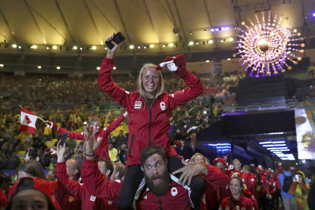 <p>The Canadian contingent takes part in the closing ceremony for the 2016 Rio Olympics on August 21, 2016. (REUTERS/Stefan Wermuth) </p>