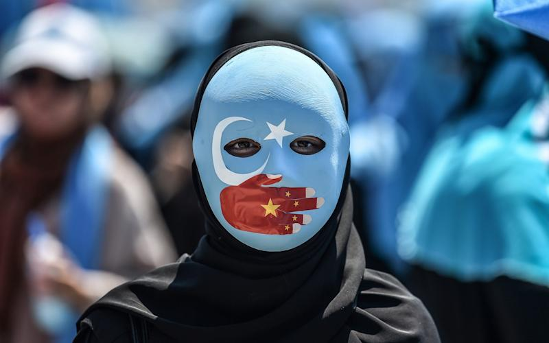 China's treatment of ethnic Uighur Muslims has drawn protest around the world - AFP