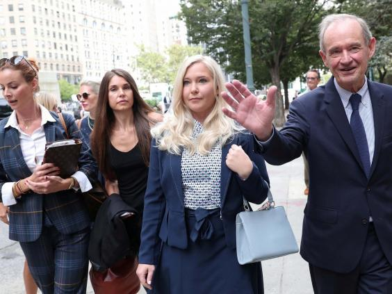Virginia Giuffre, one of Epstein's accusers, arrives with her lawyer for a hearing in the criminal case against Jeffrey Epstein in August (Reuters)