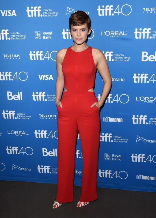 "<p>Kate Mara's red A.L.C. ""Chandler"" jumpsuit almost matched with her auburn hair on the red carpet prior to a press conference for her new movie ""Martian,"" which also stars Jessica Chastain, Matt Damon, and Chiwetel Ejiofor to name a few.</p>"