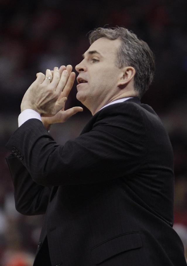 American University's head coach Mike Brennan instructs his team against Ohio State during the first half of an NCAA college basketball game on Wednesday, Nov. 20, 2013, in Columbus, Ohio. (AP Photo/Jay LaPrete)