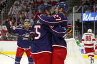 Columbus Blue Jackets' Markus Nutivaara (65), of Finland, celebrates his goal with teammate Ryan Murray (27) during the first period of an NHL hockey game against the Carolina Hurricanes in Raleigh, N.C., Saturday, Oct. 12, 2019. (AP Photo/Karl B DeBlaker)